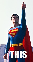 5756467-cw-stm-reeve-superman-iconic-city-pointing-pose